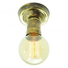 Vintage brass light bulb holder shown with a vintage filament light bulb