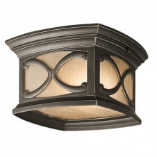 Gothic flush mount exterior light in bronze with amber tint glass
