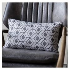 grey geometric cut out design cushion