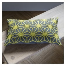 blue yellow geometric cut out design cushion
