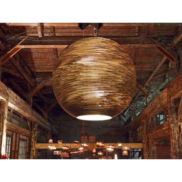 large circular sun feature light made from salvaged cardboard. Black Bedroom Furniture Sets. Home Design Ideas