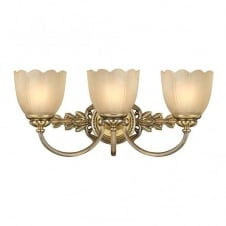 traditional over mirror bathroom wall light in brass with amber glass shades