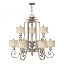 classic decorative chandelier in silver leaf finish with ivory pleat shades