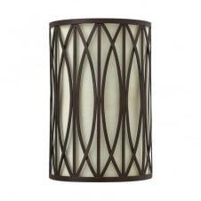 rustic wall light in bronze with patterned frame and fabric inner shade