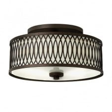 rustic ceiling pendant in bronze with patterned frame and fabric inner shade