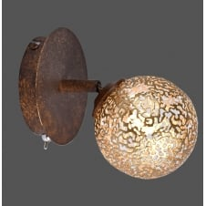 rust effect wall light with cut globe shade