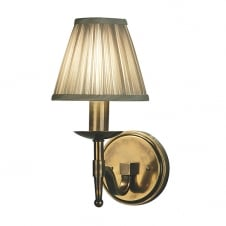 traditional antique brass wall light with beige shade