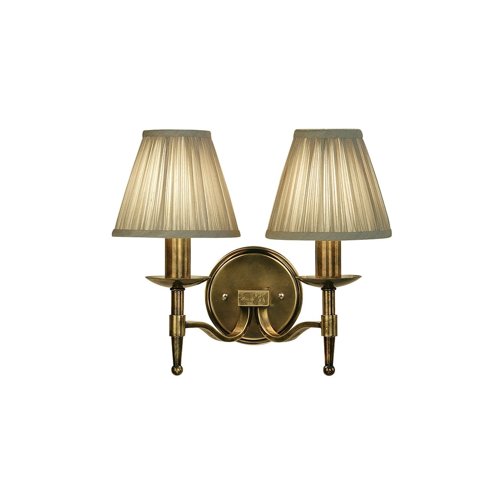 Traditional double wall light in antique brass w beige clip on shades antique brass double wall light with beige shades aloadofball Choice Image