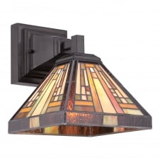 Geometric Tiffany wall sconce in bronze with warm amber tone shade