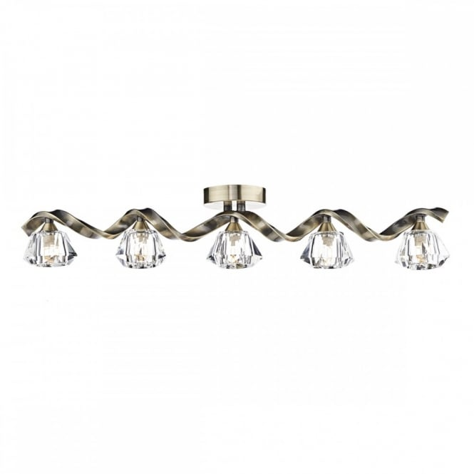 The Lighting Book ANCONA Linear flush fitting Ceiling Light. A long Twisted bar in antique brass with 5 crystal glass shades.