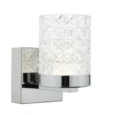 contemporary polished nickel wall light with cut glass shade